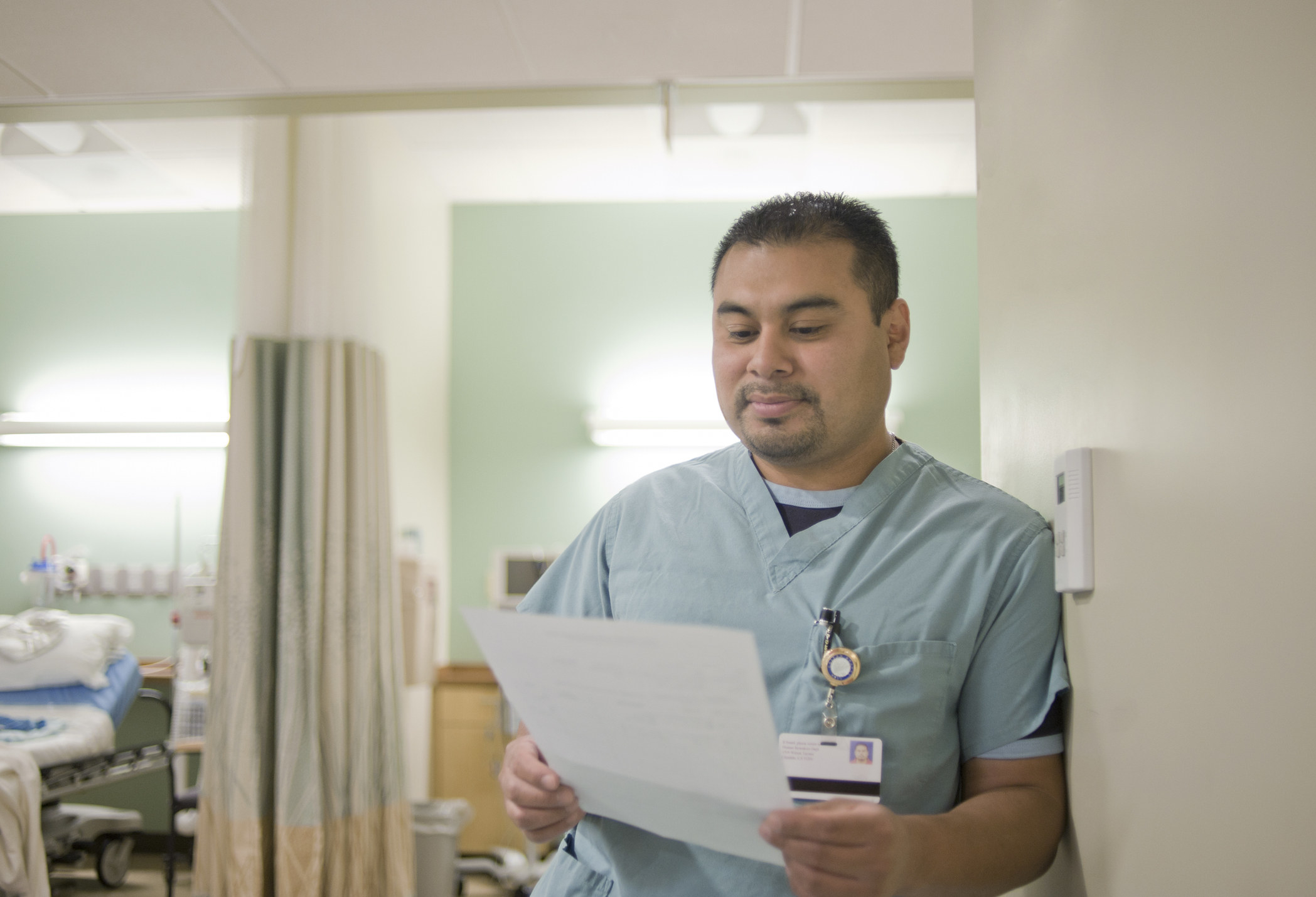 A nurse looking over paperwork in a hospital