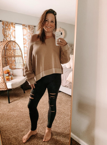 different reviewer wearing it with off-the-shoulder sweater