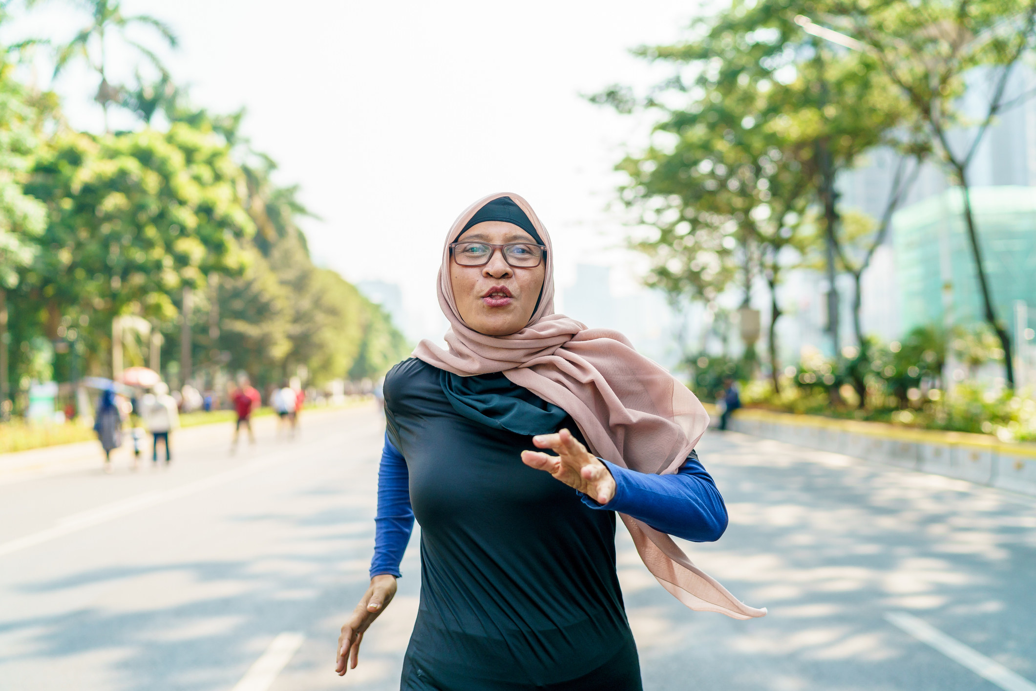 A woman running in the street for exercise