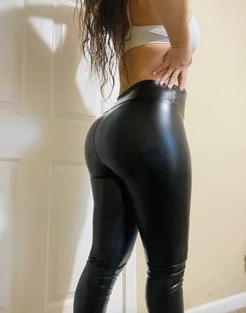 different reviewer wearing leggings and showing from back side