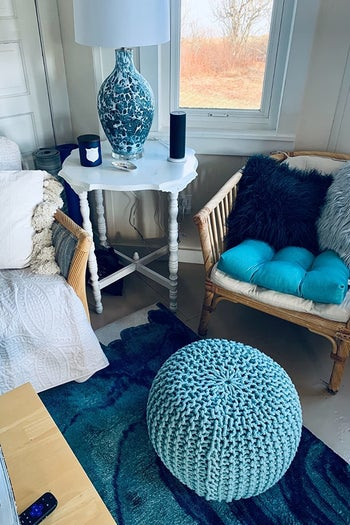 blue ottoman styled inside someone's home