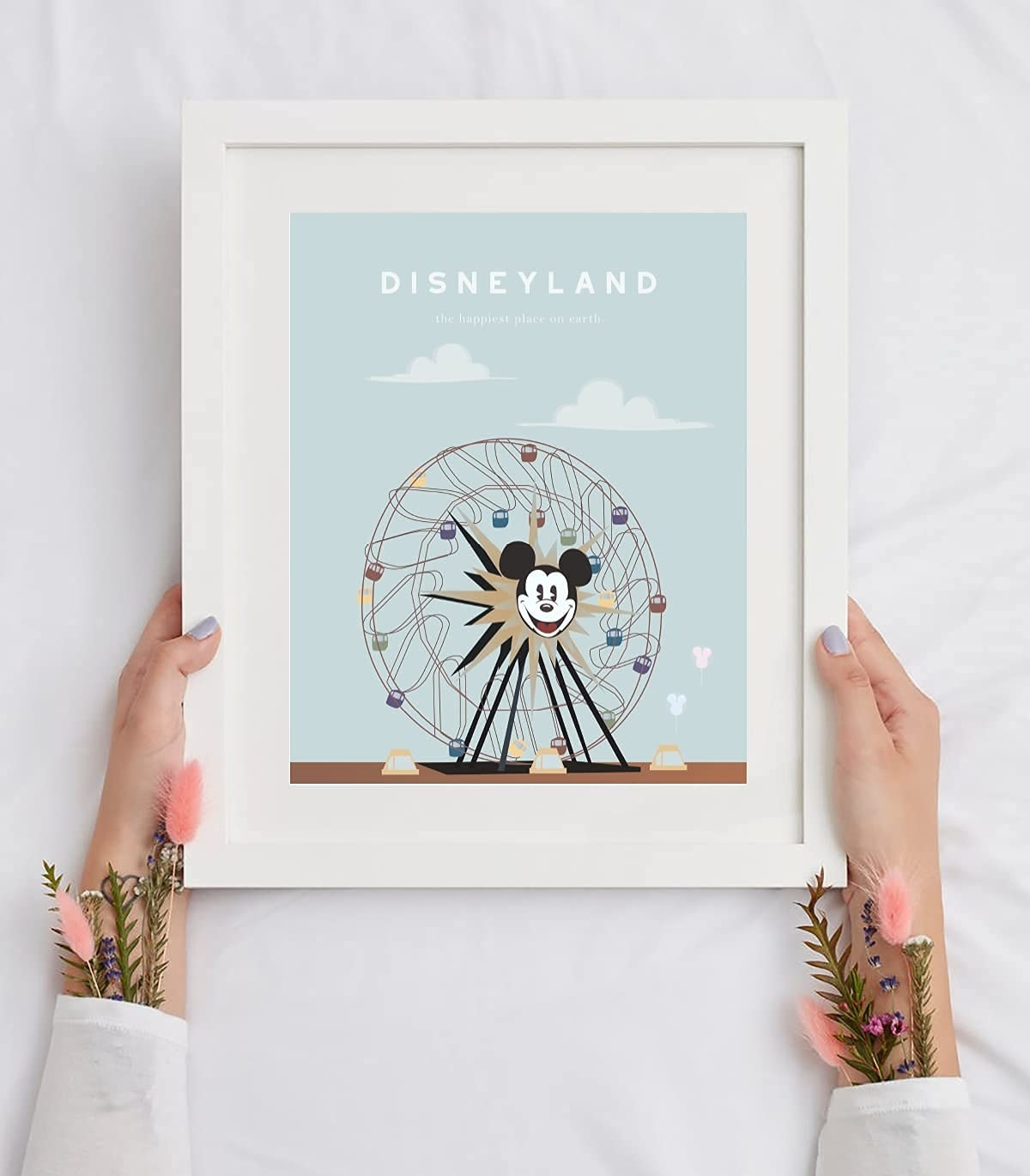 a light blue print of the ferris wheel in a white frame