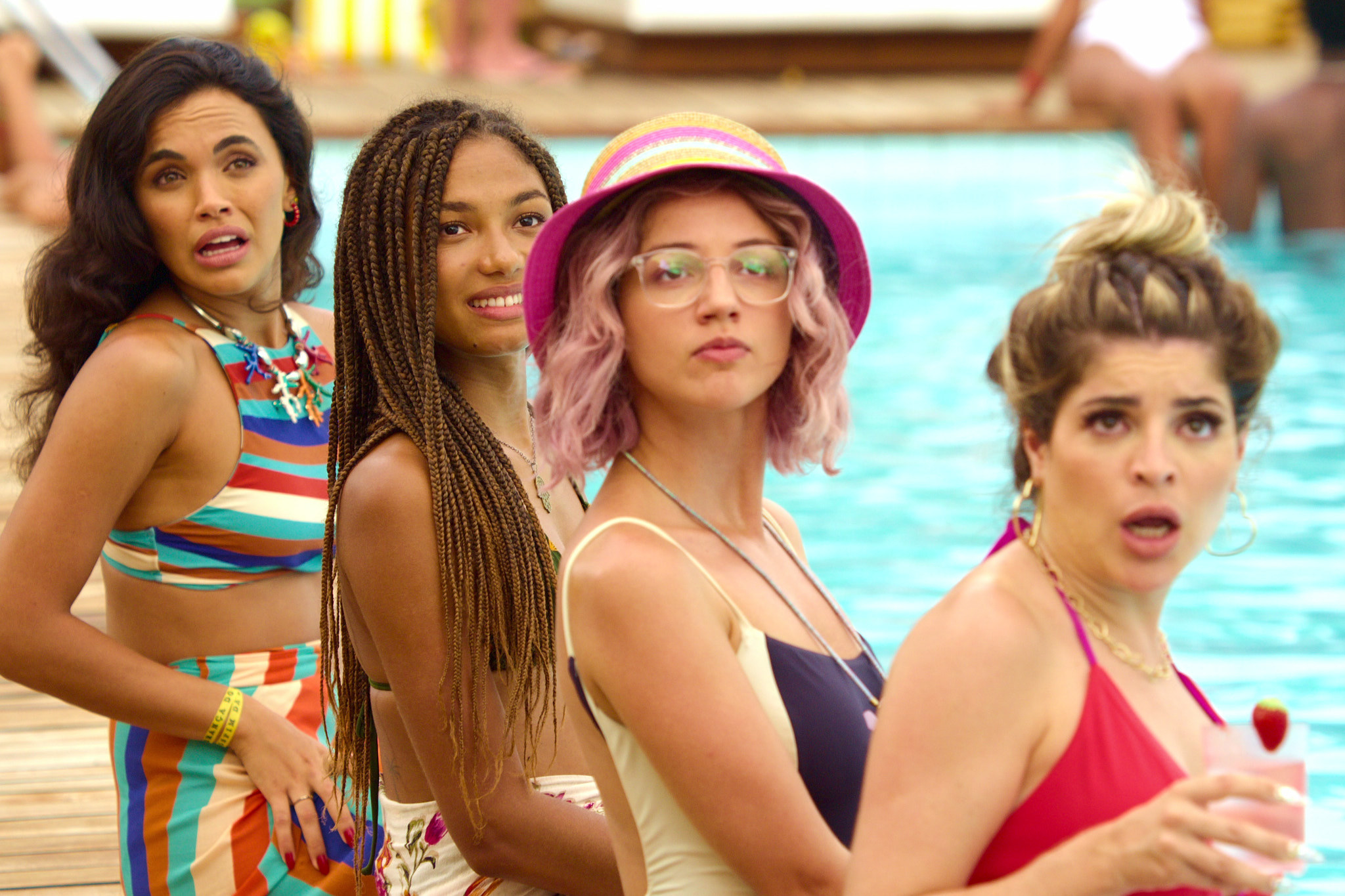 group image of three women by the pool looking in the same direction in the movie titled carnival