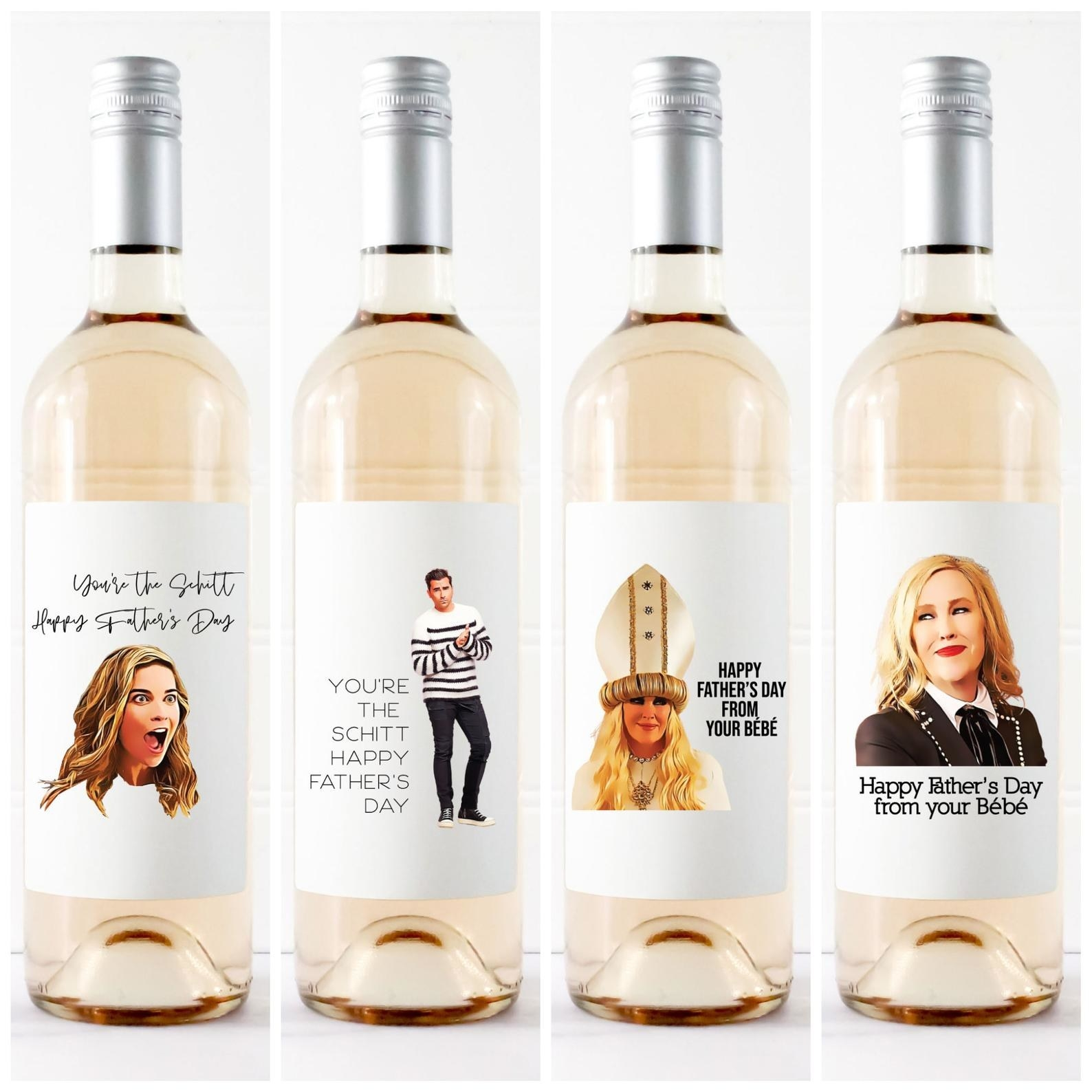 """four schitt's creek-themed labels on wine bottles that say things like """"happy father's day from your bébé"""" and """"you're the schitt, happy father's day"""""""