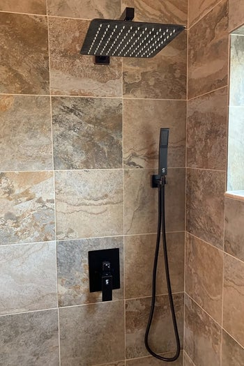 reviewer's rainfall shower in their bathroom