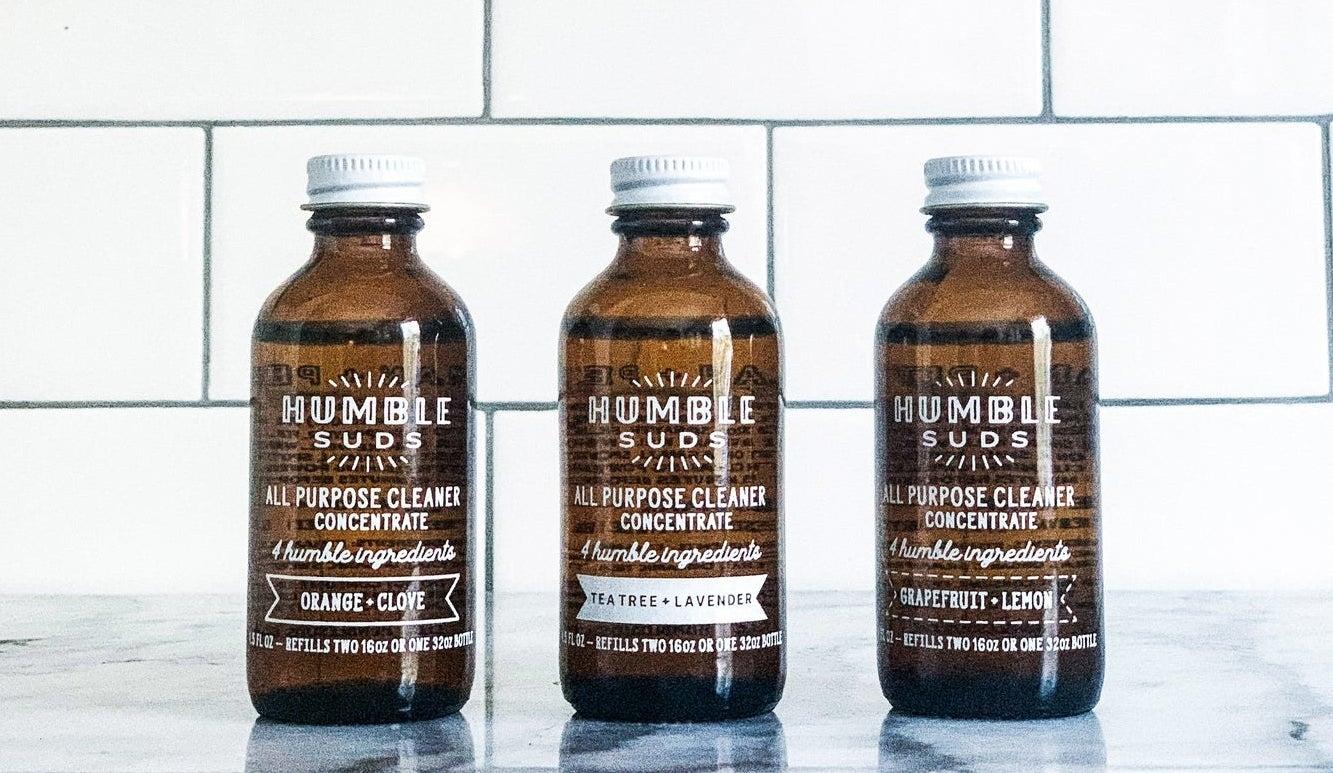 Three bottles of all-purpose cleaner in three scents