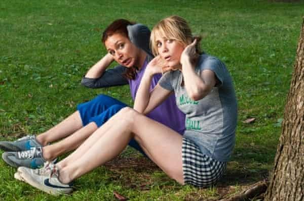 Maya Rudolph and Kristen Wiig exercising at the park