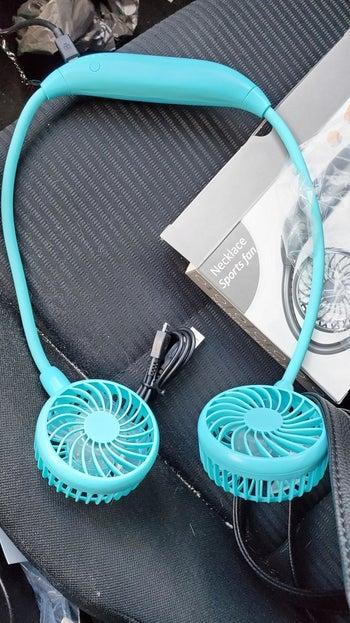 reviewer's bright blue neck fan