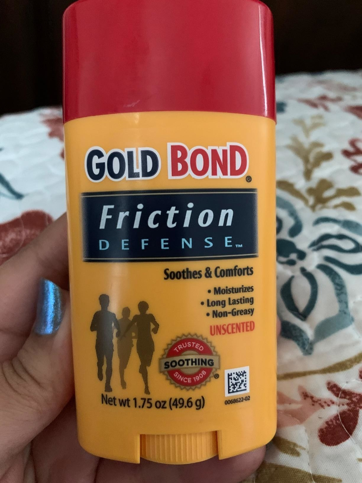 a reviewer photo of a hand holding up the gold bond friction defense stick