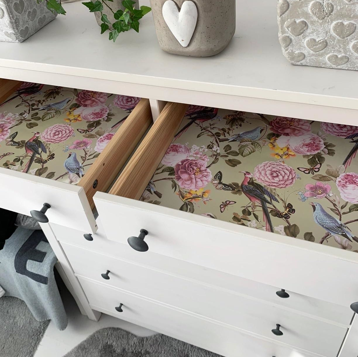 a reviewer photo of their dresser with the drawer open to show the scented drawer liner inside