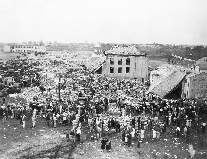 The site of a massive explosion surrounded by people