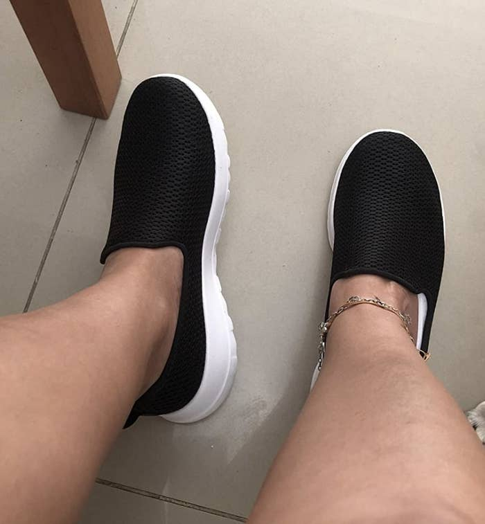 Black walking shoes with white soles