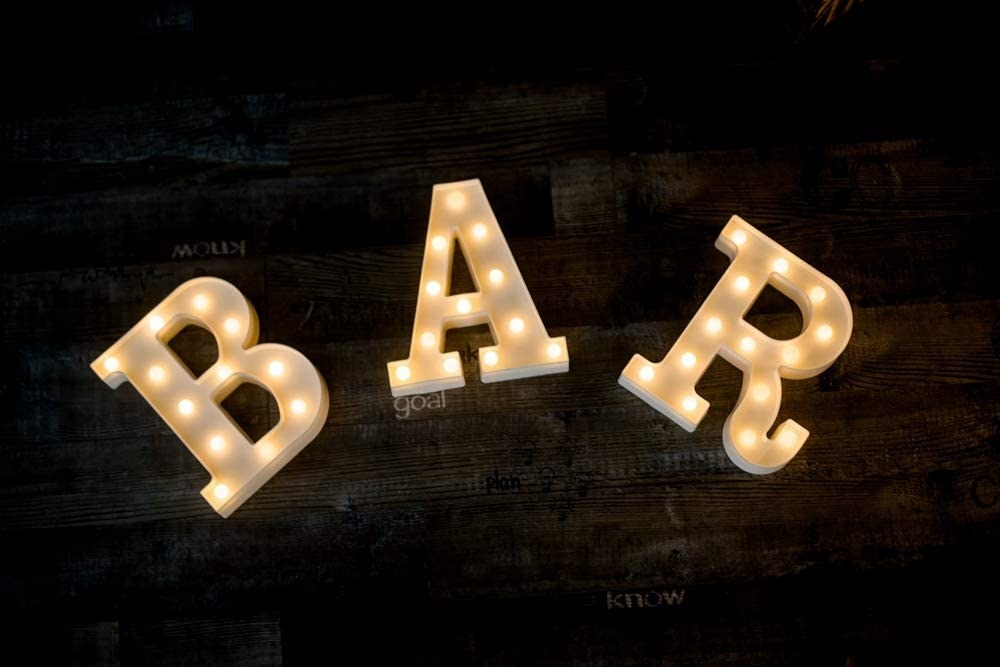 """The letters spelling out the word """"BAR"""""""