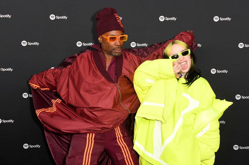 Billy Porter next to Billie Eilish, both wearing sporty track suits