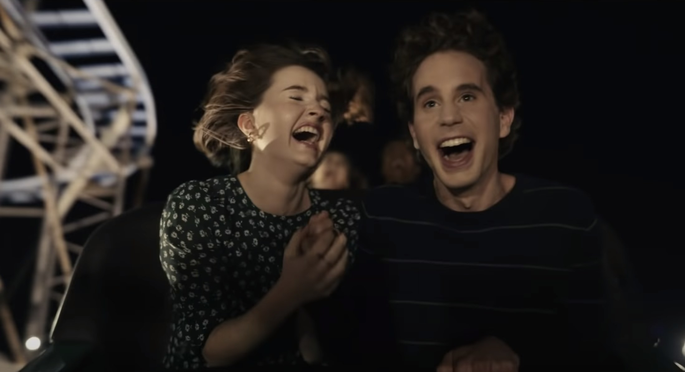 Ben and Kaitlyn ride a rollercoaster in the movie