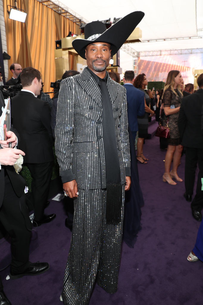 Billy Porter in a sparkly, striped suit