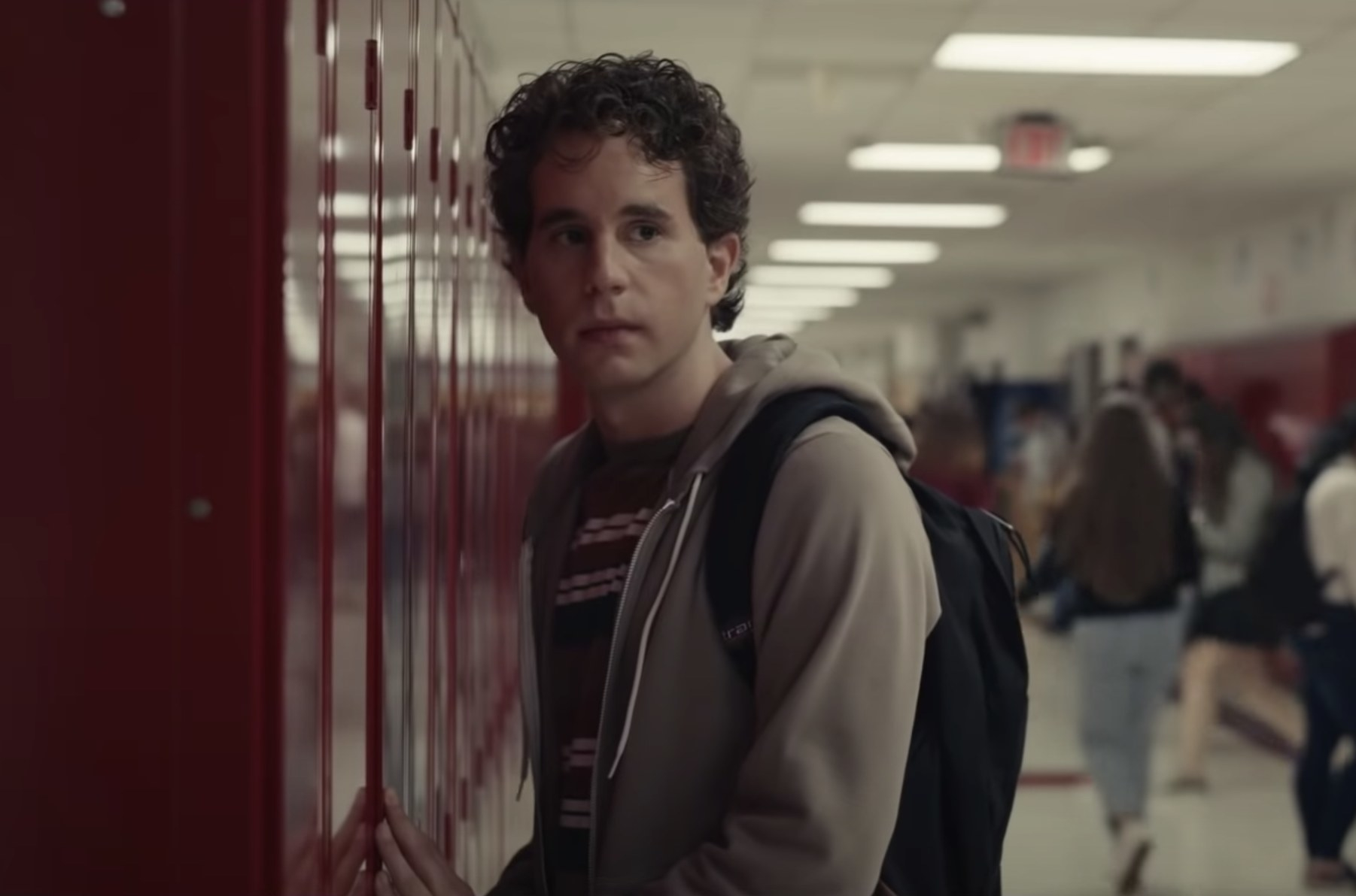 Ben stands by lockers in the movie