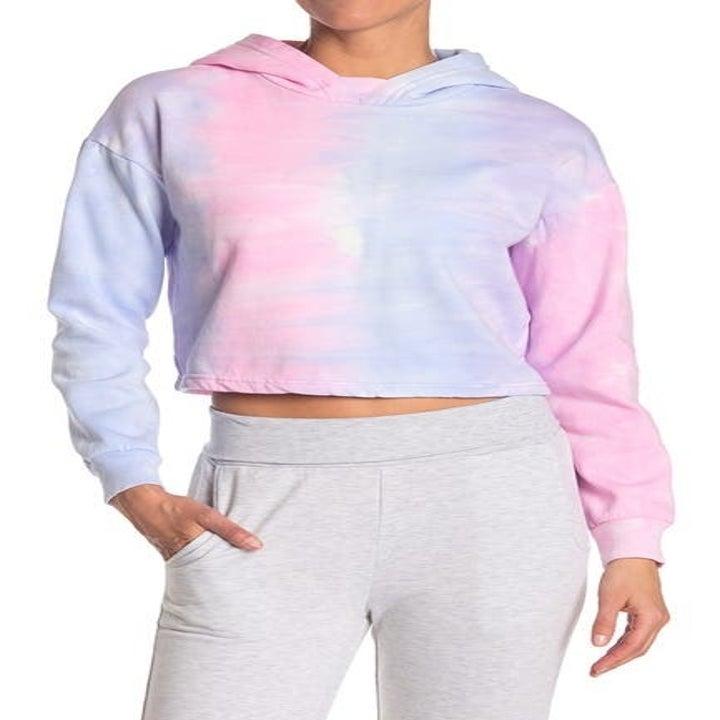 model wearing tie-dye cropped hoodie
