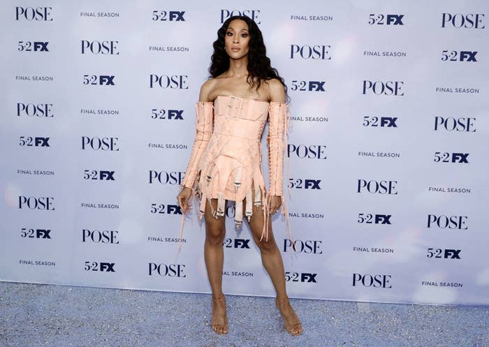 Mj Rodriguez wears a pink dress made up of many belts.