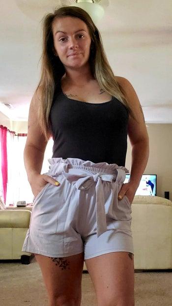 reviewer wearing blush pink paperbag shorts
