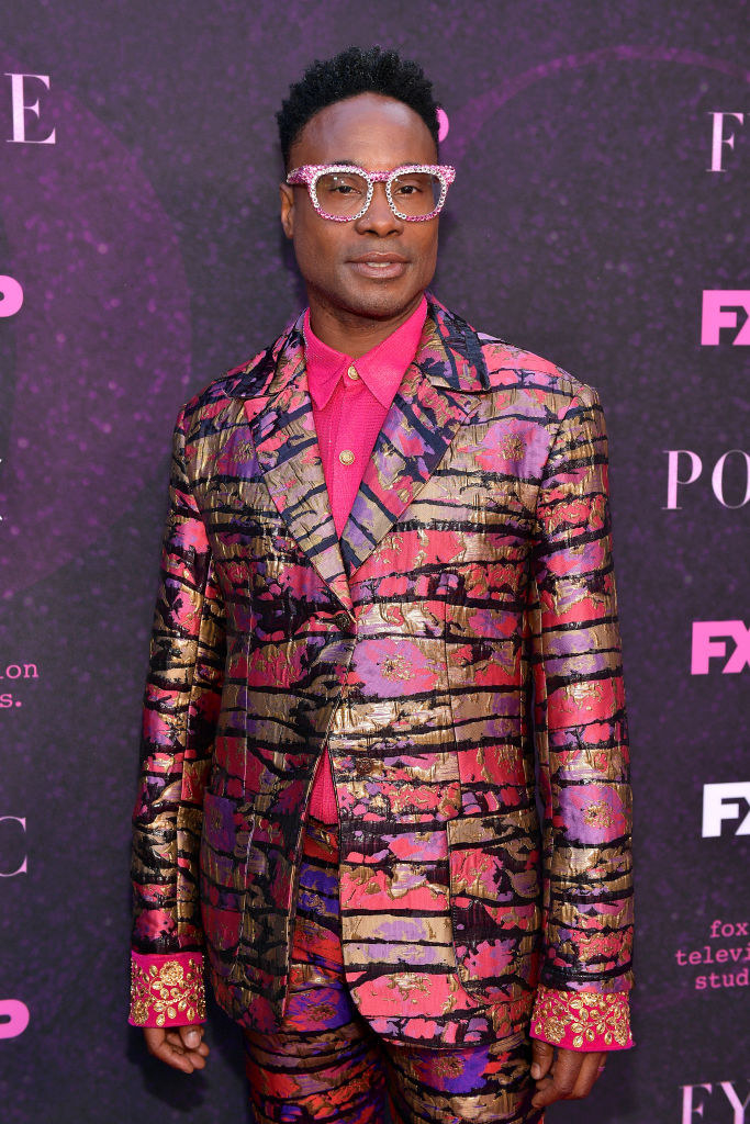 Billy Porter in a patterned pink, purple, and gold suit