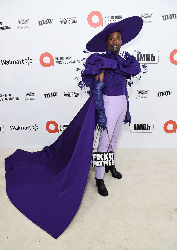 Billy Porter in an ornate purple cape and ensemble