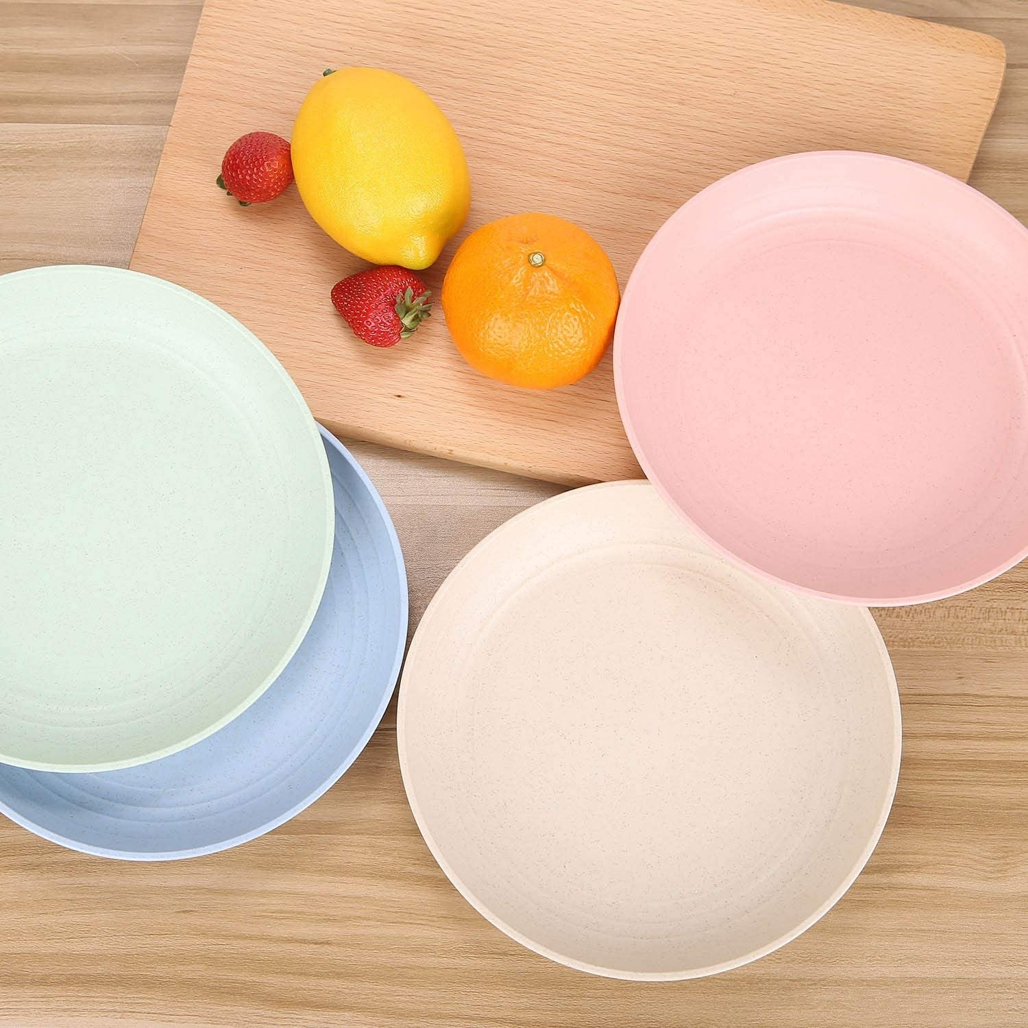 The plates in pink, light blue, light green, and tan