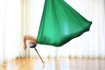 Person laying inside the hanging fabric