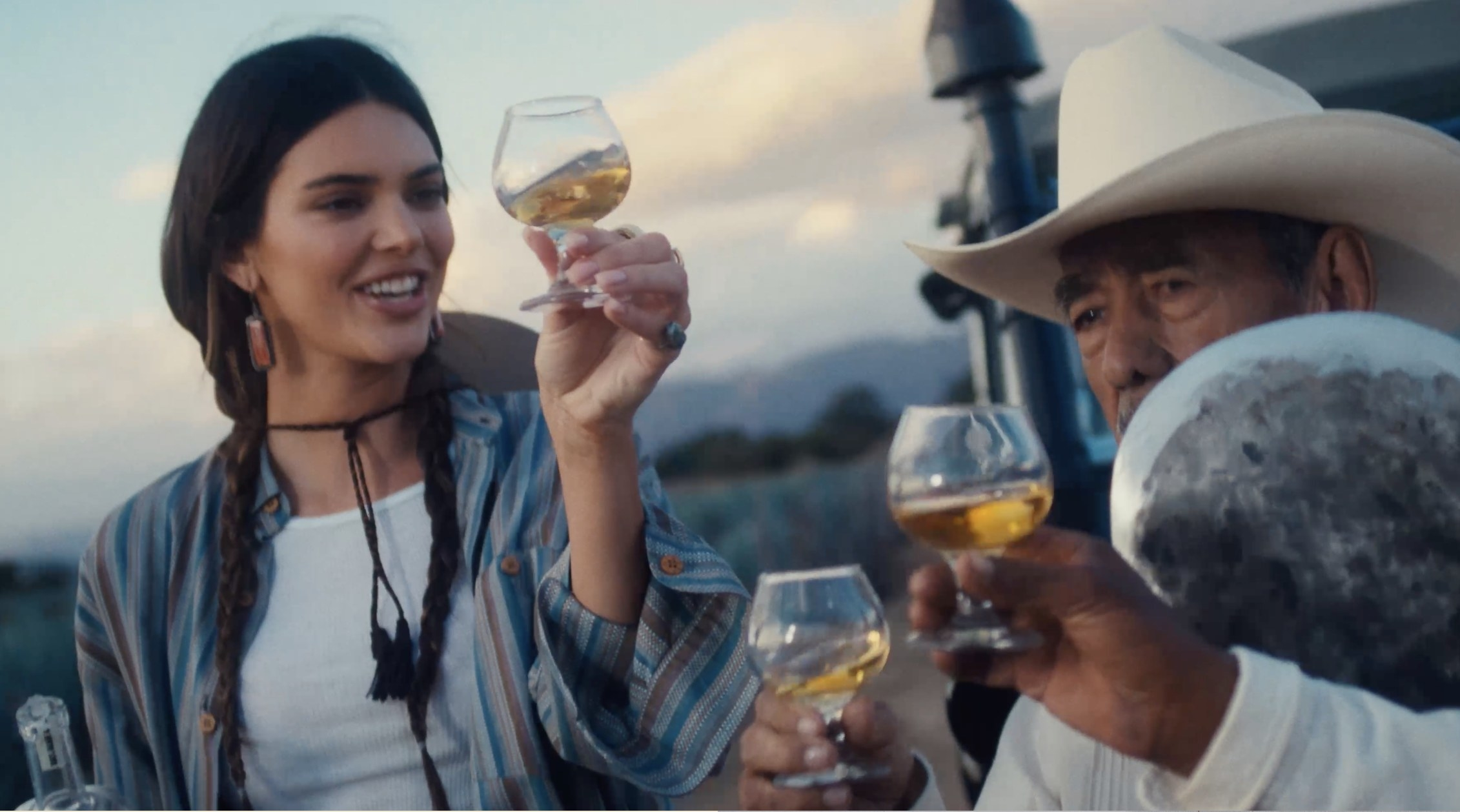 Kendall raises a glass with the farm workers
