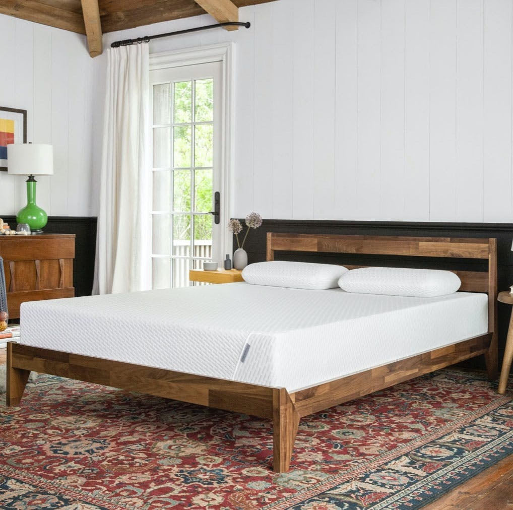 white mattress on a bed