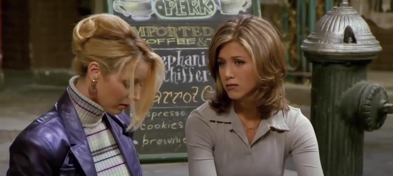 Phoebe and Rachel having a conversation on the sidewalk