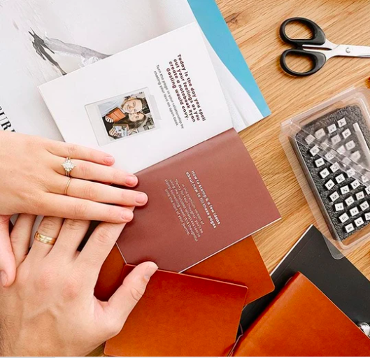 couple's hands doing a leater stamping activity