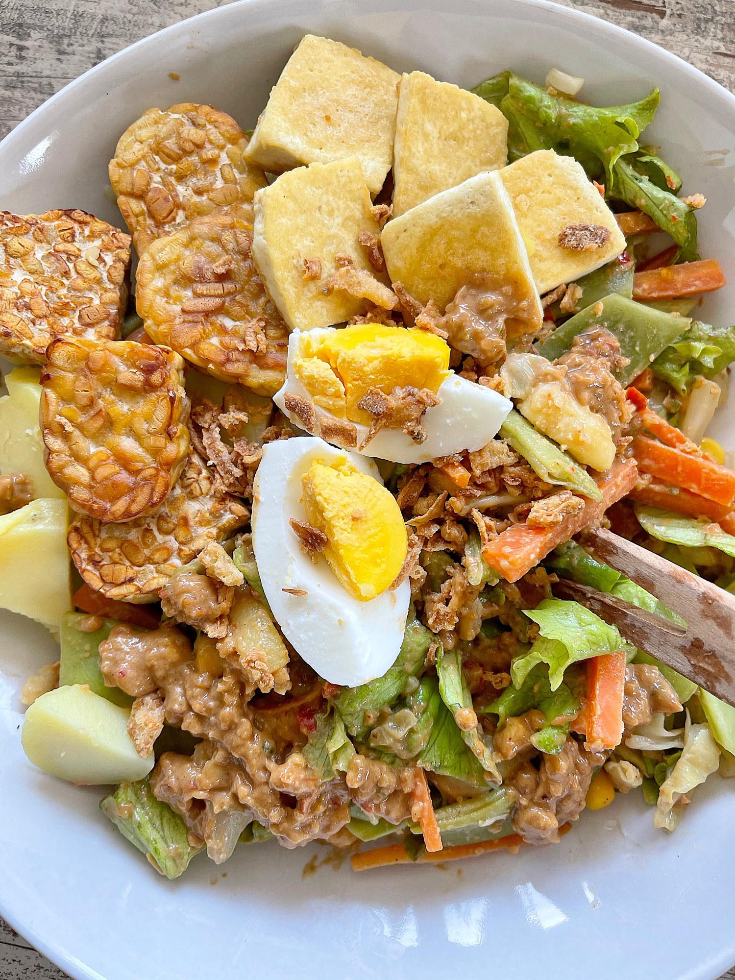 Indonesian gado gado aka vegetables, egg, and tempeh with peanut dressing.