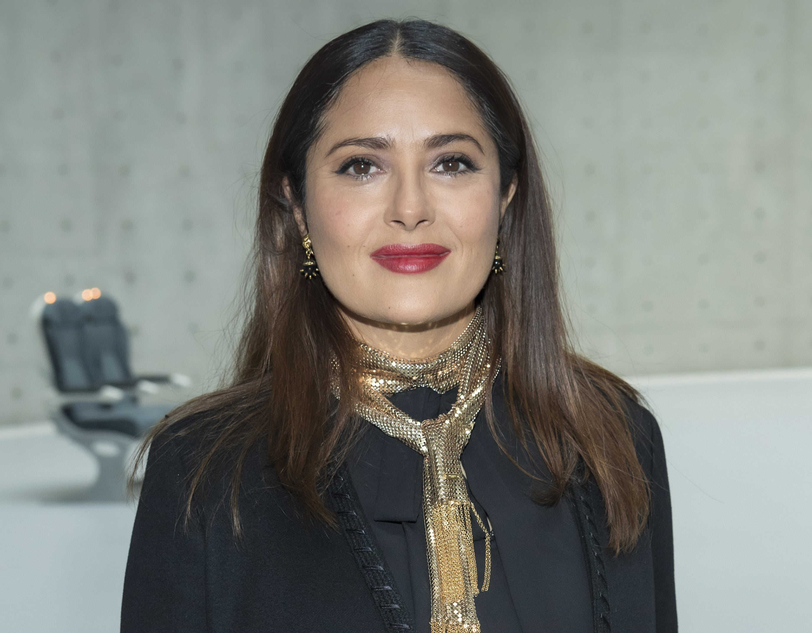 Salma wears a gold scarf while attending a recent event