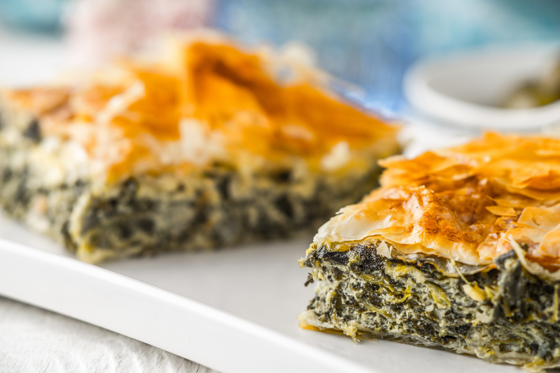 Spanakopita, phyllo dough stuffed with spinach and cheese.