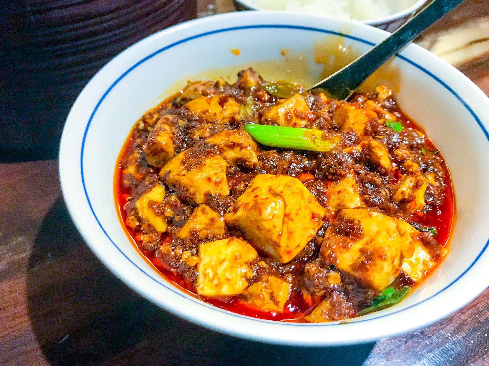 A bowl of mapo tofu with pork.