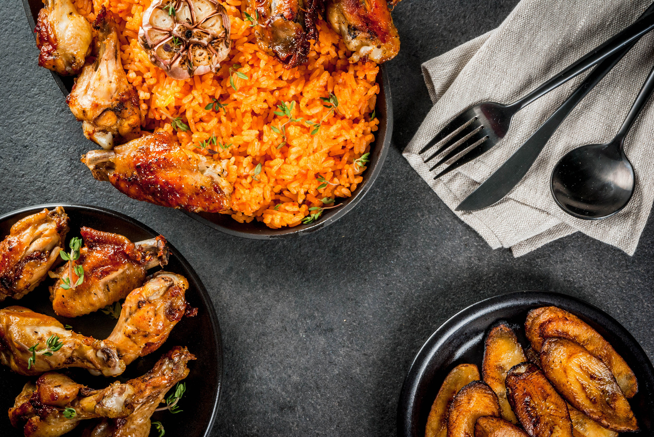 Jollof rice with chicken and plantains.