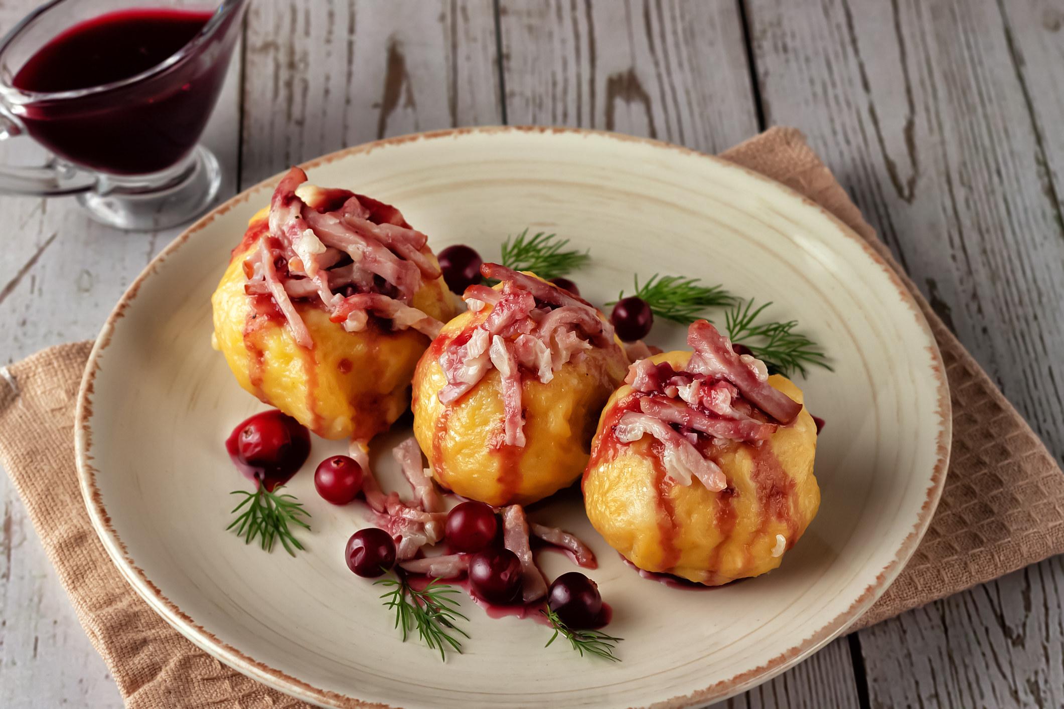 Swedish potato dumplings with gravy and berries.