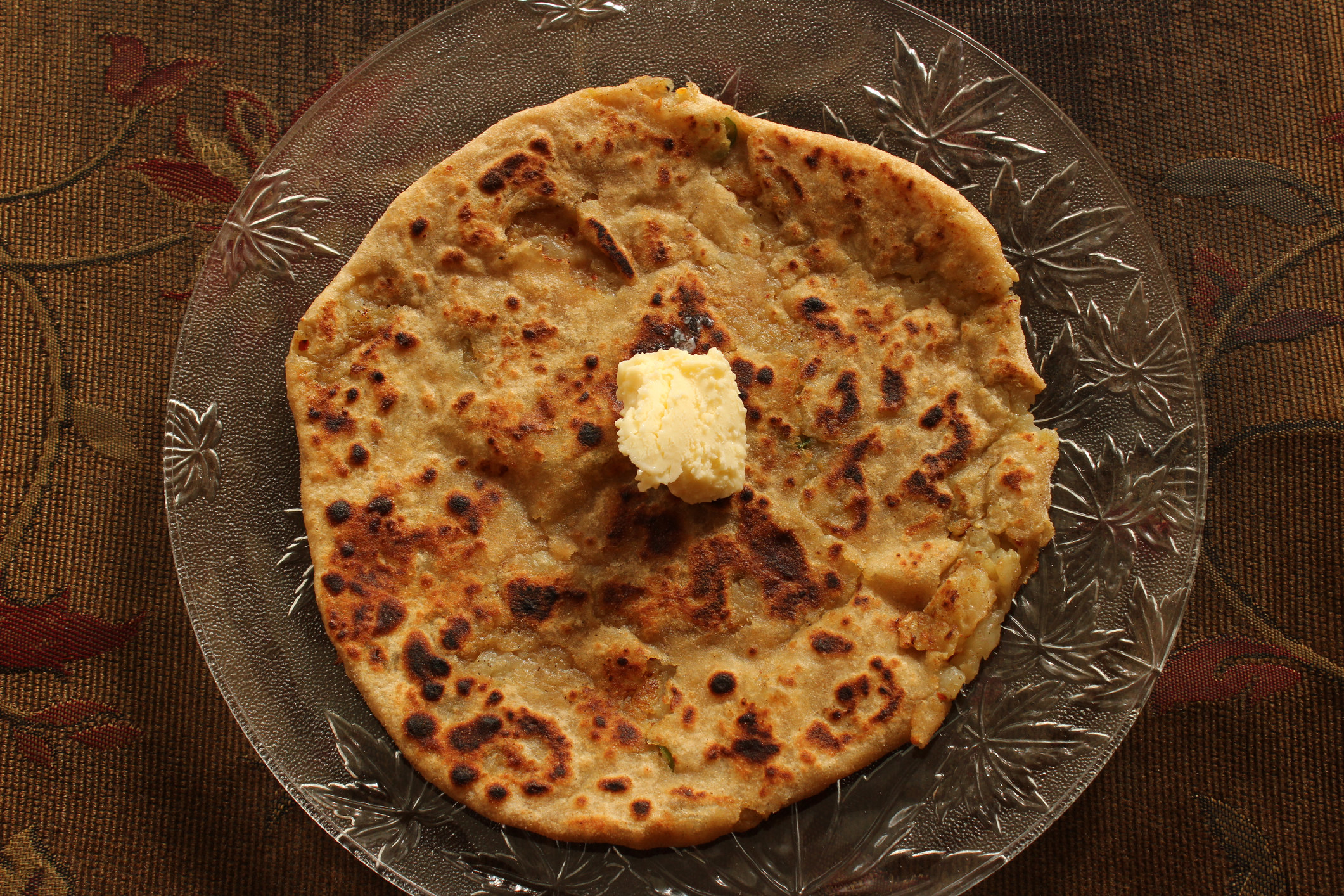India: aloo paratha with ghee.