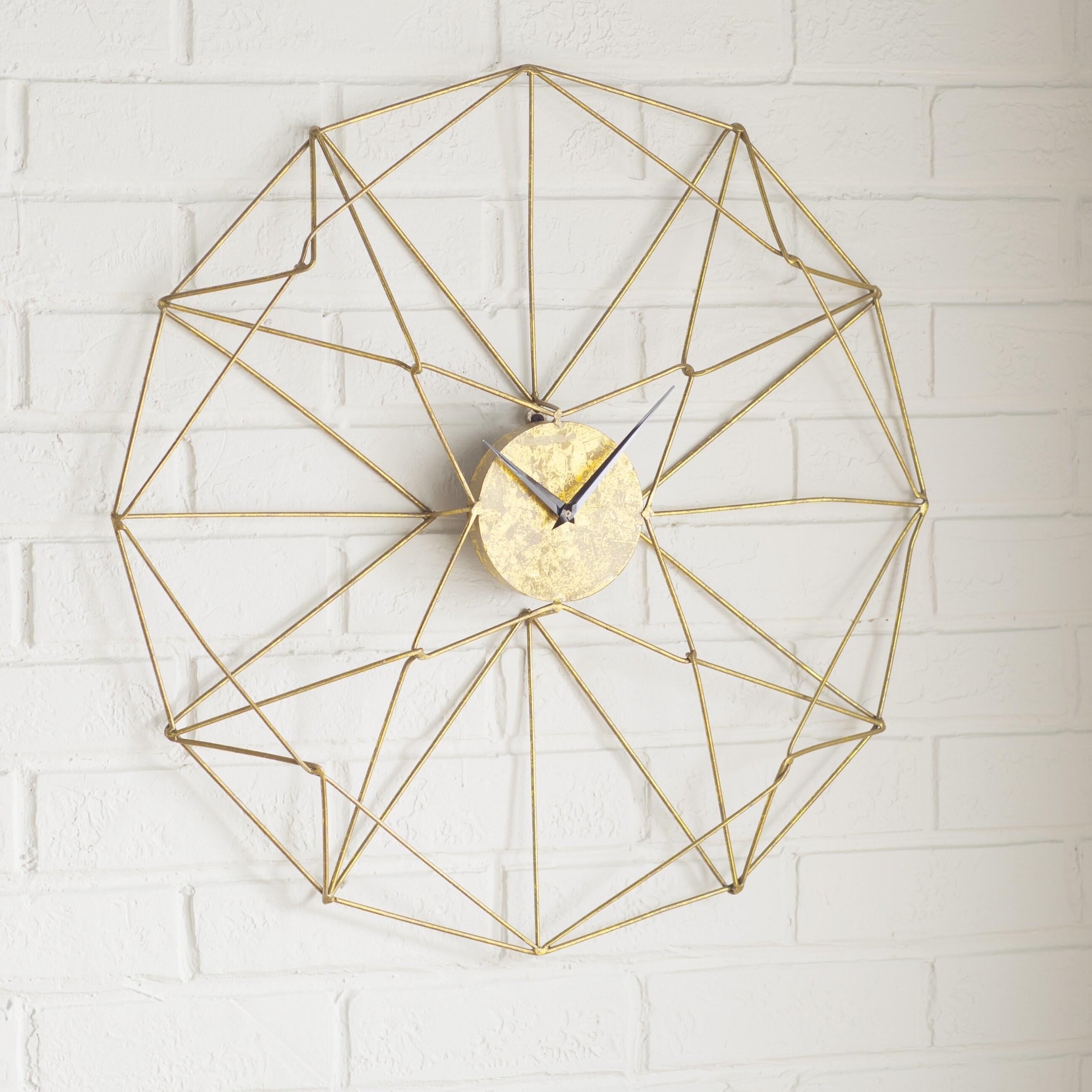 Circular clock with golden metal pattern and black clock hands