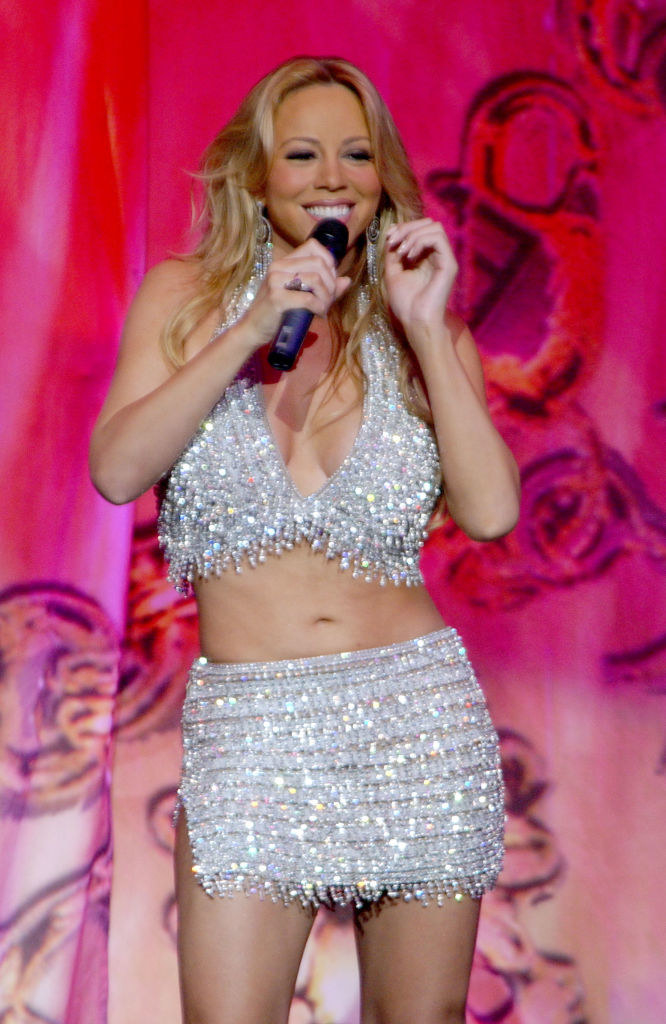 Mariah in a matching, sparkly halterneck top and skirt combo