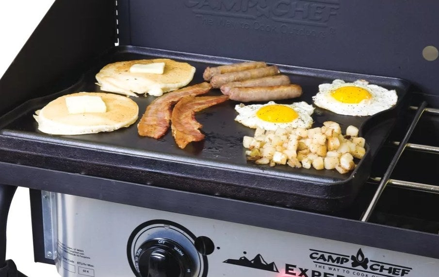 Cast Iron cooking eggs, pancakes, bacon, sausage, and hash browns