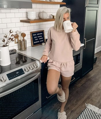A taupe loungewear set on a reviewer