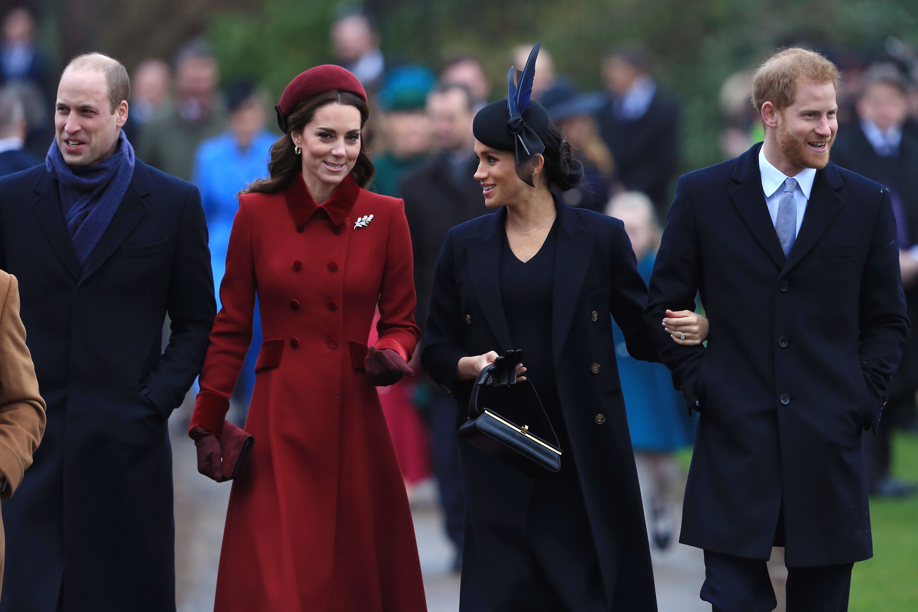Harry, Meghan, Harry and William walk together outside