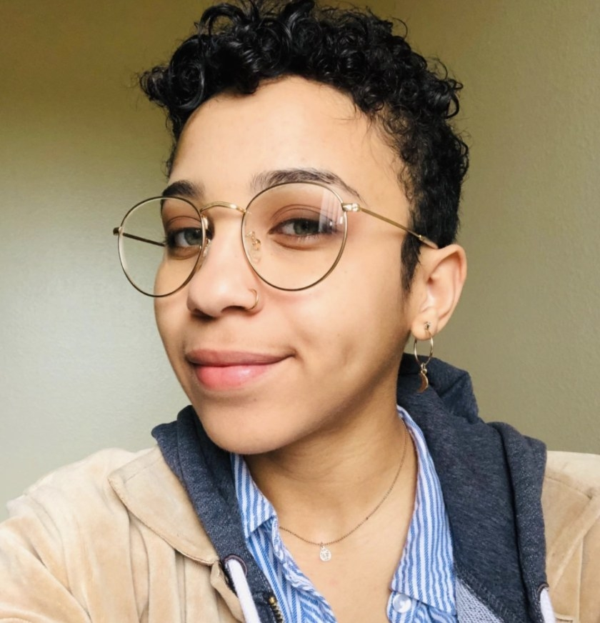 Reviewer photo of a person wearing round glasses