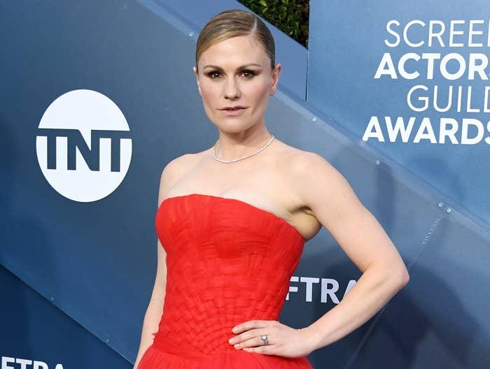 Anna wears a red strapless dress