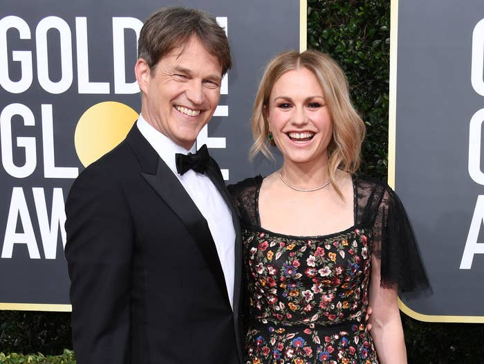Anna and Stephen smile while at an award show
