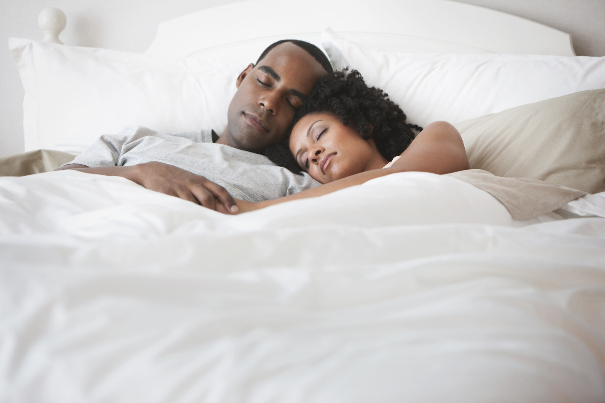 A couple sleeping in bed