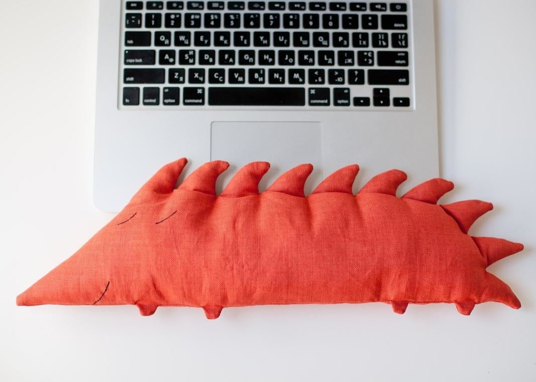 The hedgehog wrist rest in front of a laptop