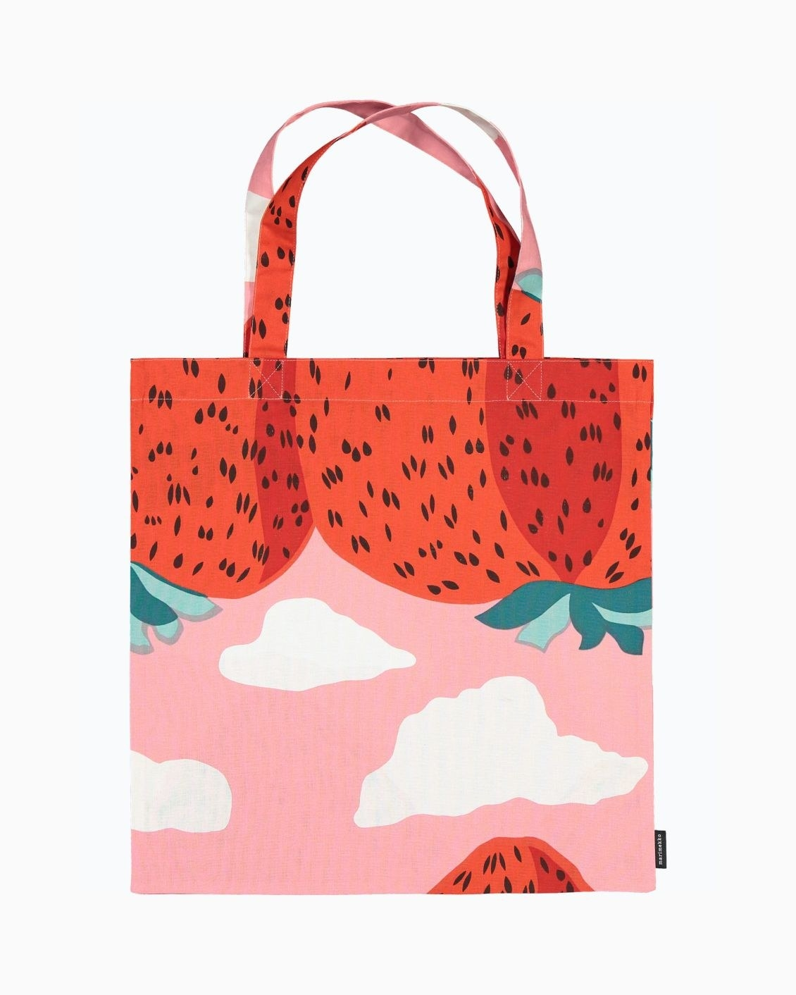 tote bag with strawberry mountain design and a pink sky with clouds